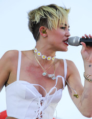 Miley Cyrus also accessorized with a gold-plated alien pendant by OK1984 x Kreayshawn.