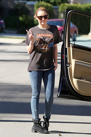 Miley Cyrus stayed on-trend in black lace up ankle boots.