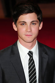Logan Lerman wore his hair in a side part for the premiere of 'The Three Musketeers.'