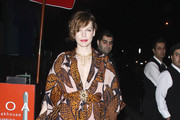 Milla Jovovich wears a colourful patterned kaftan to dinner with her husband Paul W.S. Anderson at BOA steakhouse in Los Angeles.