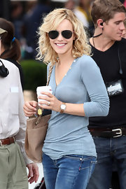 Rachel was spotted on set wearing a casual ensemble with dark aviator shades.