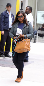 Mindy Kaling kept her look casual and cool while on the streets of NYC, where she wore this gray leather jacket.