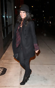Jessica was stylish in New York with a black wool coat over a plaid button-up.