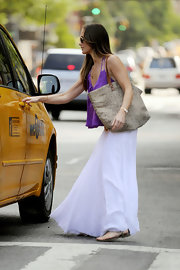 Minka Kelly looked perfectly summery carrying a neutral leopard print tote with leather straps.