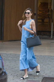 Miranda Kerr complemented her airy dress with an elegant gray Louis Vuitton leather tote during a shopping trip in Paris.