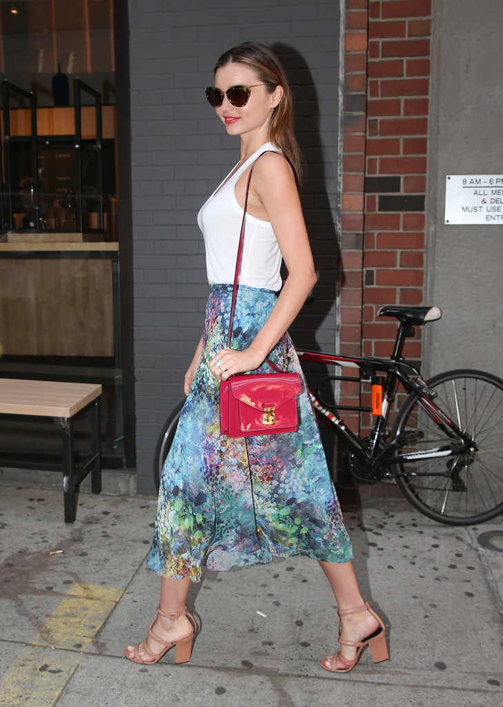 Miranda Kerr seen smiling while walking around, after leaving the studio in New York City
