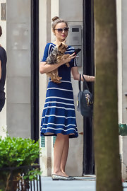 Miranda Kerr took her dog for a walk wearing an adorable pair of quilted silver ballet flats.