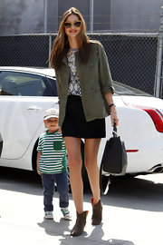 Miranda Kerr chose a hip utility jacket to pair over her blouse and mini for a cool and unexpected mix of styles.