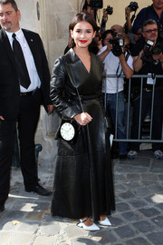 Miroslava Duma was all covered up in an ankle-length black leather coat during the Christian Dior fashion show.
