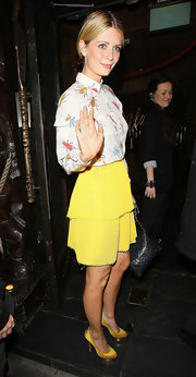 Mischa wore a sweet yellow pleated skirt with her beetle print top for a night out in London.