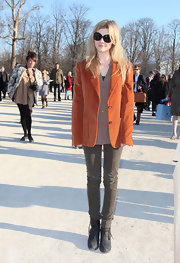 Clemence Poesy looked casual at the Chloe show in rugged brown ankle boots.
