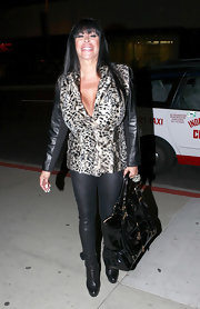 Angela Raiola carried a large patent tote on her way to a dinner at Boa steakhouse.