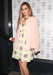 Amber Le Bon pulled off a girly outfit -- a print dress and a pink blazer -- at the Eleven Paris opening party.