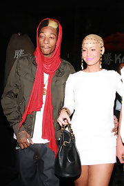 WiZ Khalifa was out on the town with Amber Rose wearing a red knit scarf around his hair and neck.