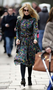 Claudia wore a floral print dress with a leather belt while out in London.