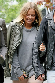 Lara Bingle traveled light in Sydney carrying a petite black leather hard case clutch covered in gold studs.