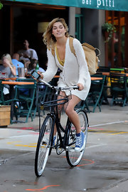 Ashley Hart was spotted riding her bicycle wearing a pair of blue high-top sneakers.
