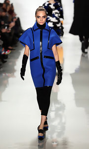 Cara Delevingne matched her blue coat with pointed cap-toe pumps at the Michael Kors fashion show.