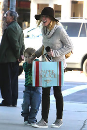 Julie Bowen was out and about town in a floppy hat, knit sweater and canvas shoes.