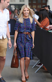 Mollie went for a classic with this blue plaid dress, which she belted and paired with brown pumps and a matching brown handbag.