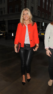 Mollie King showed off her super-chic street style with a pair of black pointy pumps, leather pants, and a bright jacket.