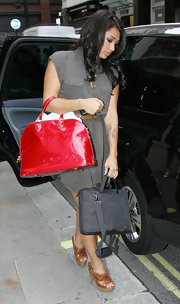 Vanessa White paired her tan clogs with a patent leather tote bag.