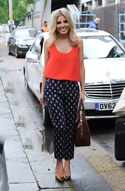 Mollie stepped out looking super chic when she paired this sleeveless red blouse with printed pants.