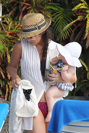 Myleene Klass tossed on a straw hat for the pool in Barbados.