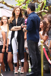Maggie Q appeared on 'Extra' wearing fierce black-and-white cap-toe pumps with wide ankle wraps.