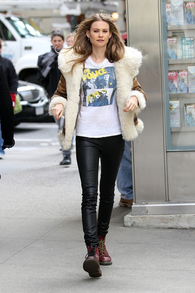 Namibian supermodel Behati Prinsloo is seen out for a stroll around Midtown Manhattan. Prinsloo looked ready to rock in leather pants, a fluffy jacket and a shirt for 70's rock band The Police shirt.