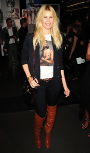Claudia showed her support for friend Naomi while looking oh-so-stylish in a navy blazer and caramel over-the-knee boots.