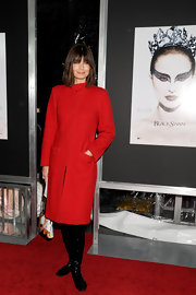 Paulina looks cozy and sophisticated in a long red coat and knee-high patent boots at the 'Black Swan' premiere.