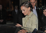 Natalie Portman wore her hair pinned up in a sophisticated updo while leaving her hotel in Pairs.