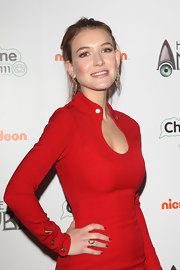 Nathalia Ramos styled her premiere night look with a pair of golden leaf earrings.