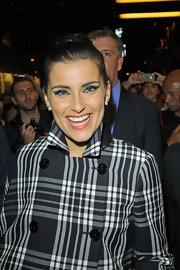 We got a close look at Nelly Furtado's bright green cat eyes!