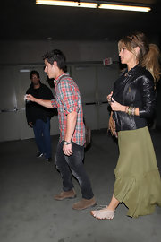 Delta Goodrem layered a black leather jacket over a maxi dress for a movie date with Nick Jonas.