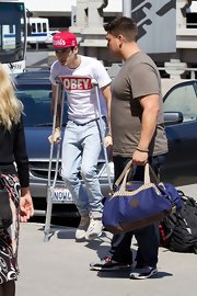 While on cruches, Zayn paired this Obey tee with classic jeans and a cap.