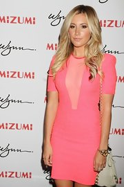 "Ashley Tisdale accessorized her pink mesh dress with this ""Amber Pierced Pouch"" at the Wynn in Vegas."