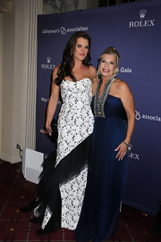 The princess looks stunning in blue chiffon while she poses with Brooke Shields.