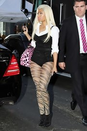 For a performance in NYC, Nicki Minaj wore a pair of black ankle boots dotted with shiny accents.