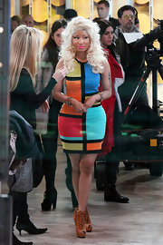 Nicki added drama to her bandage dress with cognac lace-up ankle booties.
