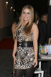 Carmen dons a wide leather belt with buckles over her leopard print dress at the Social Club in Hollywood.