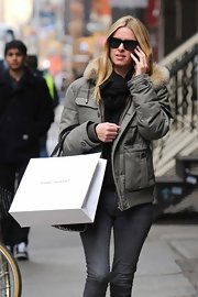 Nicky Hilton bundled up in this ultra-warm winter jacket with a fur-trimmed hood while out in NYC.