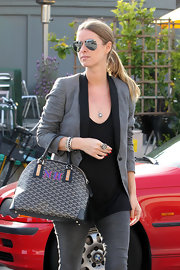 Nicky wore a black and silver pendant necklace wile at Lemonade restaurant in LA.