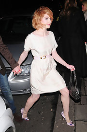 Nicola Roberts gave her dress a girlie finish with pale pink satin pumps embellished with multicolored gems.