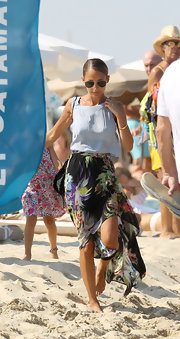 Nicole kept her look light and airy with a pale blue blouse and flowing tropical skirt.