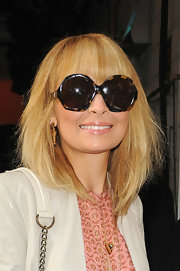 Nicole Richie wore her hair in a layered bob with long bangs while spending time in NYC.