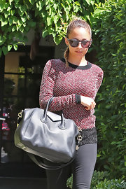 Nicole Richie's modern circular sunnies were the perfect contrast to her slicked back braid.