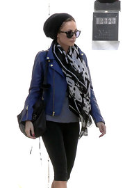 Nicole Richie showed her hippie style with a blue leather jacket and printed scarf after a workout.