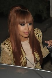 Rebecca Ferguson contrasted her futuristic outfit with a retro bouffant for an episode of 'The X Factor.'